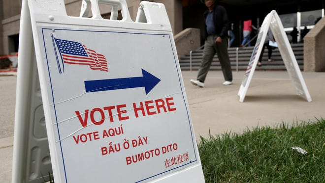 Signs direct voters outside of the Santa Clara County Registrar of Voters.