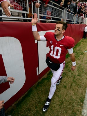 Alabama Crimson Tide quarterback A.J. McCarron (10) celebrates by making a victory lap around the stadium after their 49-0 win over the Chattanooga Mocs at Bryant-Denny Stadium.