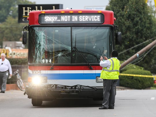 A TARC bus with windshield damage is stopped on Bardstown