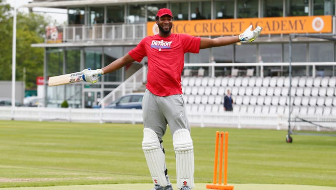 Detroit Pistons center Andre Drummond celebrates after he scores a six in cricket with the Middlesex Cricketers on June 2, 2016 in London.
