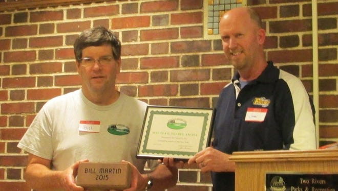 Bill Martin, left, receives the Friends of Mariners Trial ninth annual Trail Blazer award from president John Brunner.
