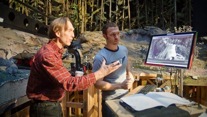 """Henry Selick (left) and lead animator Travis Knight work on """"Coraline"""" in this production photo from the 2009 movie."""