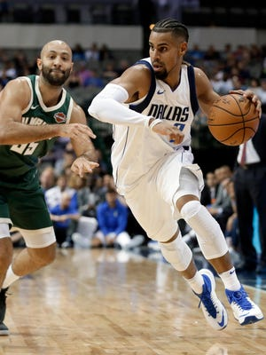 Gian Clavell drives past Milwaukee Bucks defender Kendall Marshall during a preseason game Oct. 2 in Dallas. Clavell signed a two-way contract Monday with the Mavericks, allowing him to play in the NBA and with its developmental league affiliate this season.