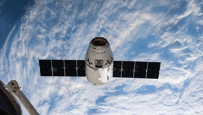SpaceX's Dragon spacecraft is seen arriving at the International Space Station on Wednesday, April 4, 2018 after launch from Cape Canaveral two days prior.