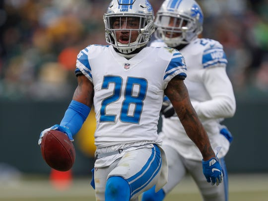 Detroit Lions' Quandre Diggs reacts after intercepting a pass during the second half of an NFL football game against the Green Bay Packers Sunday, Dec. 30, 2018, in Green Bay, Wis. (AP Photo/Matt Ludtke)