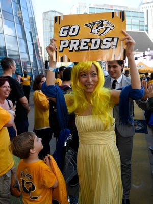 Christina Shaw cheers the Predators during the Gold Walk on Lower Broadway Tuesday, Oct. 10, 2017 in Nashville, Tenn.