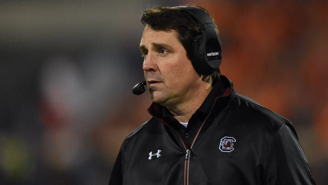 South Carolina head coach Will Muschamp stands on the sidelines during the third quarter of the Gamecocks' game against Clemson.