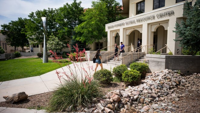 Students climb the steps of a building on the Western New Mexico University campus.