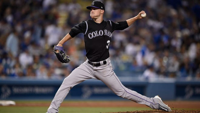 Colorado Rockies pitcher Kyle Freeland (31) pitches against the Los Angeles Dodgers during the sixth inning at Dodger Stadium.