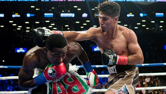 Mikey Garcia, right, throws a right hand at Adrien Broner on Saturday night. He won a unanimous decision.