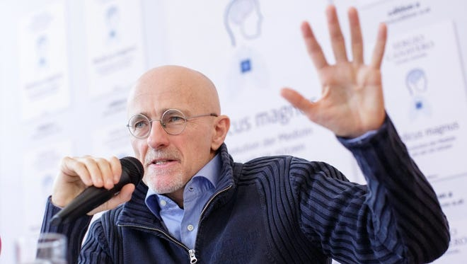 Italian neurosurgeon Sergio Canavero gestures as he speaks during a news conference in Vienna, Austria, on Nov. 17.