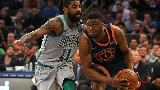 New York Knicks point guard Emmanuel Mudiay (1) controls the ball against Boston Celtics point guard Kyrie Irving (11) during the first quarter at Madison Square Garden.