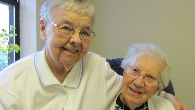 Sister Mary Martha, left, and her friend of more than 40 years, Dorothy Von Rotz, share a hug. Von Rotz was one of the founding members of the associate program.