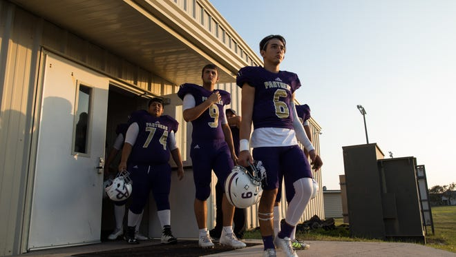 The Aransas Pass football team walks out on to the field to warms up for their game against Wharton at Bo Bonorden Memorial Stadium in Aransas Pass on Friday, Nov. 3, 2017.