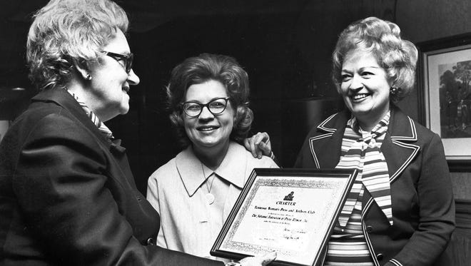 January 25, 1975 - Mrs. Naomi Whitsell of Indianapolis (left) and Mrs. Charlotte Schexnayder of Dumas, Arkansas, (center) present a Federation of Press Women Inc., affiliation charter to Dr. Rosemary Stephens at a luncheon on Jan. 25, 1975, at Quality Inn-Poplar East. Dr. Stephens is president of the Tennessee Woman's Press and Authors Club, a 75-year-old organization which voted in October to become a NFPW affiliate. Mrs. Whitsell, national NFPW president, owns a public relations firm. Mrs. Schexnayder, national NFPW communications contest chairman, is editor of The (Dumas) Clarion.
