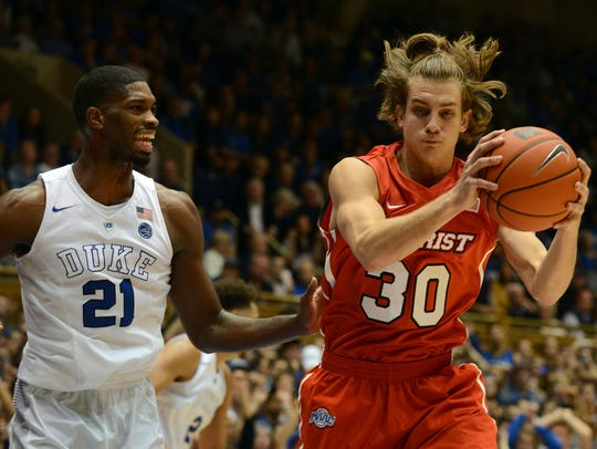 Marist College's Ryan Funk grabs the ball in a game against Duke at Cameron Indoor Stadium in Durham, North Carolina last season.