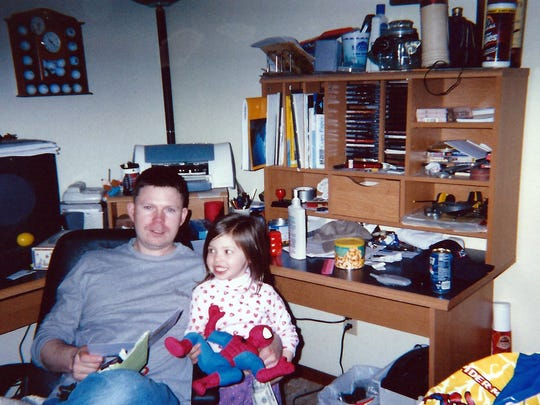 Alexis Myers and her father, John, are shown in April 2005, just a couple months before she turned 4. Alexis' hearing issues appeared in a preschool hearing test.
