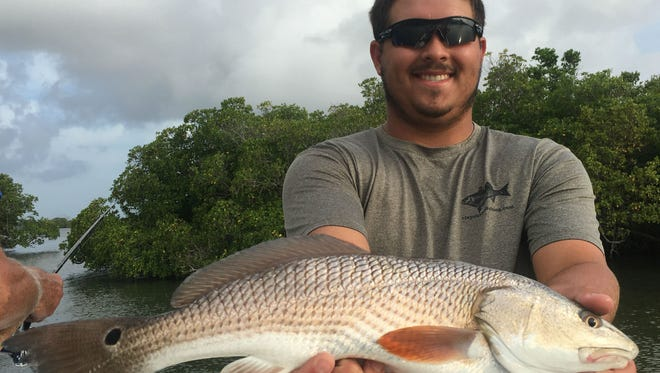 Clay Jennings, of Fort Pierce, caught and released this redfish while fishing with Capt. Charlie Conner of Fish Tales guide service out of The Fishing Center in Fort Pierce.