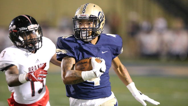 Pearl's Jphnquarise Patterson runs for a 78-yard touchdown after catching a pass from Jake Smithhart to give Pearl a 7-0 lead as Brandon's Booker Ficklin defends on the play. Pearl beat Brandon to claim the Region 3-6A title.