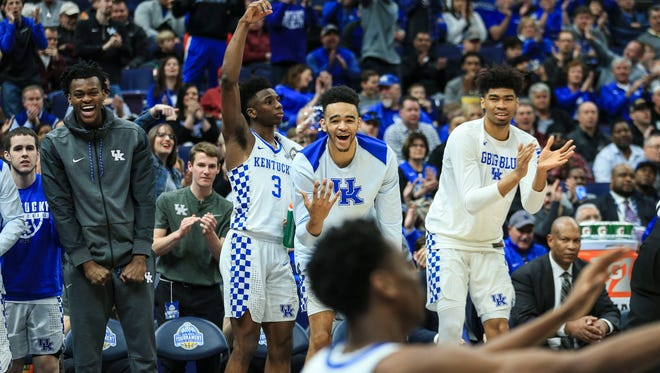 The Kentucky bench explodes with cheers after  Shai Gilgeous-Alexander scores two and draws the foul against Georgia in the 2018 SEC Tournament in St. Louis. Alexander finished with 15 points.