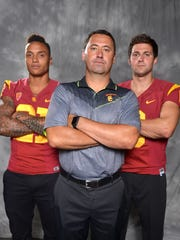 Southern California Trojans linebacker Su'a Cravens (left), coach Steve Sarkisian (center) and quarterback Cody Kessler at Pac-12 Media Day at Warner Bros. Studios.