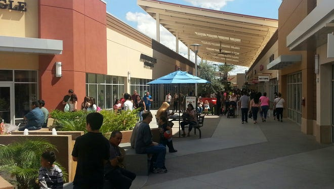 Tanger Outlet Mall in Glendale provides shoppers with a sense of place, from covered walkways to seating outside shops.