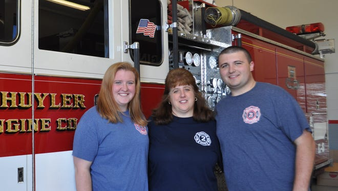 Marissa Piscal (left) is the newest member of the North Arlington Fire Department. She is joined by her mom, Diane Eckardt Piscal, and brother, Matthew Piscal.