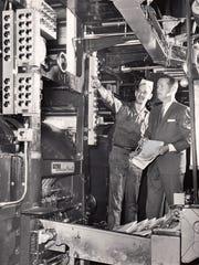 Phoenix Newspapers Inc. pressman Lyle Hawk, left and Phoenix Newspapers Inc. general manager Howard Wilcox in the press room on November 28, 1965.