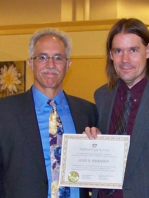 Howard Miskey,left,retired managing attorney for the Lebanon office of MidPenn Legal Services, presents a certificate of appreciation recently to John Gragson, as the PBA William H.G. Warner Pro Bono Attorney of the Year.