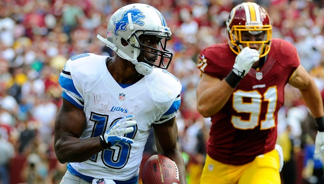 Lions wide receiver Nate Burleson runs after a reception as Redskins linebacker Ryan Kerrigan gives chase.