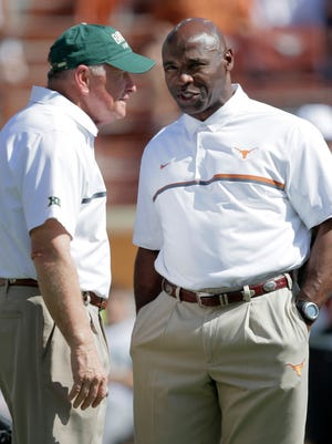 Baylor Bears coach Jim Grobe and Texas coach Charlie Strong talk before their game at Darrell K Royal-Texas Memorial Stadium.