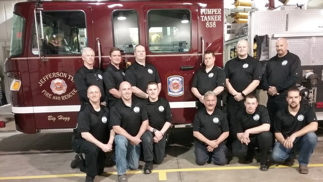 Front, from left, areMike Swick, Brian Knowlton, Marcus Fagan, Safety Officer Keith Neale, Josh Gibson, and Lt CodyKnapp; and back, areGordon Grove – Honorary member Christopher Webb, Matt Grove, Chief Dave Link,Capt. Andy Rehm and Assistant Chief Ric Cochran.