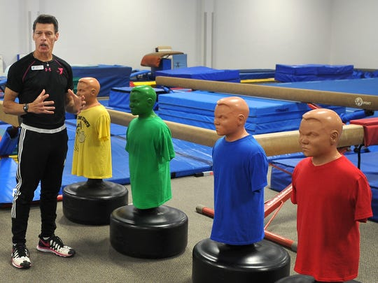 In this file photo, YMCA gymnastics director, Joe Cronin talks about the gymkata teaching tools he uses to teach his students about self-discipline and not to spar among one another.