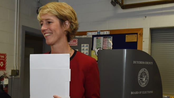 Zephyr Teachout, a candidate in the Democratic Congressional primary for the 19th district waits to cast her ballot in Tuesday's primary election at the East Clinton Fire District in Clinton Corners.