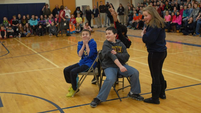 Students participate in 'U R LUV'D' assembly at Marysville Middle School hosted by SONS Outreach and Power 88.3 WNFA on Wednesday.