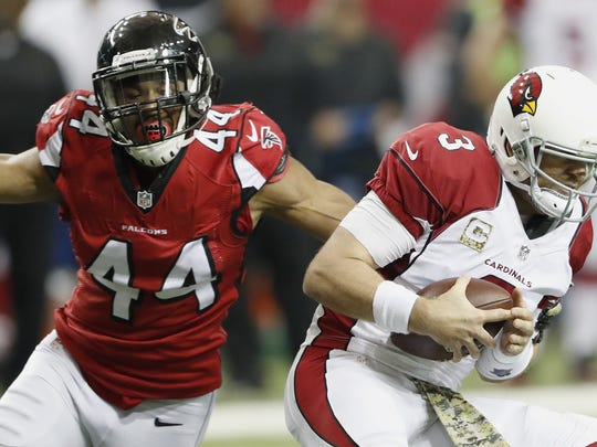 Atlanta Falcons outside linebacker Vic Beasley (44) hits Arizona Cardinals quarterback Carson Palmer (3).