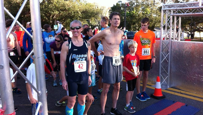 Runners, including eventual winner Jonathan Howse, left, line up for start of the Tail of the Lizard 2-miler.