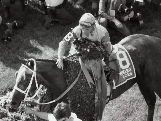 Jockey Gary Stevens congratulates Winning Colors after the 1988 Kentucky Derby.