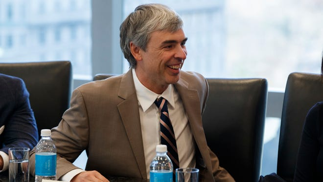 Alphabet CEO Larry Page speaks during a meeting with President-elect Donald Trump and technology industry leaders.