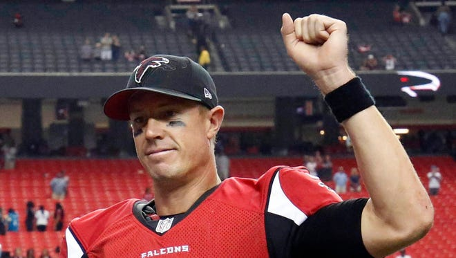 Atlanta Falcons quarterback Matt Ryan (2) celebrates after their game against the Carolina Panthers at the Georgia Dome.