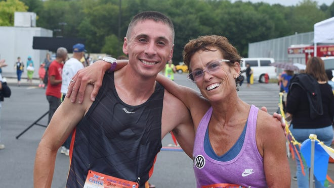 The 2016 5K winners, Marisa Sutera Strange, right, of Pleasant Valley, and Jamie Stroffolino, 30, of Stormville, pose together at the Dutchess County Classic on Sept. 18, 2016 in Freedom Plains.