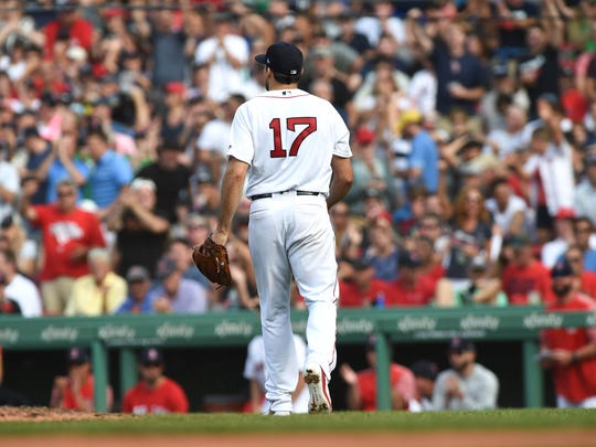 Aug 4, 2018; Boston, MA, USA; Boston Red Sox starting pitcher Nathan Eovaldi (17) walks to the dugout after pitching during the seventh inning against the New York Yankees at Fenway Park.