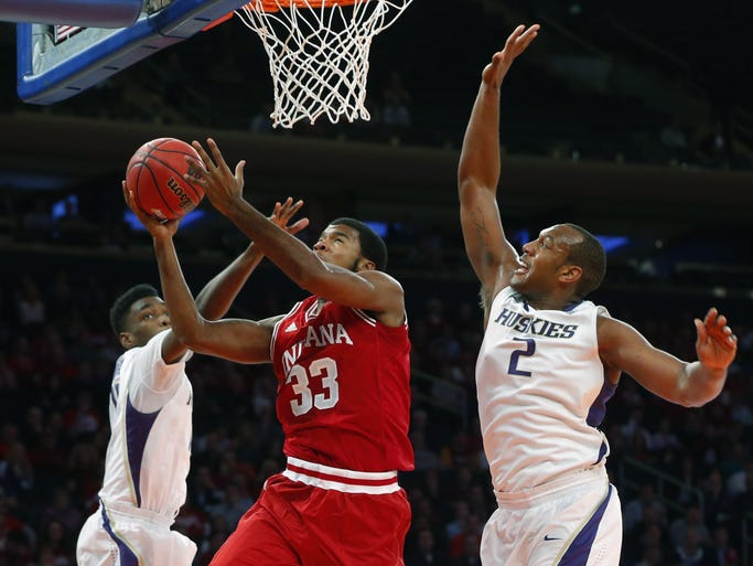 Nov 21, 2013; New York, NY, USA; Indiana Hoosiers forward Jeremy Hollowell (33) drives to the basket during the first half against Washington Huskies forward Perris Blackwell (2) and guard Darin Johnson (1) at Madison Square Garden. Mandatory Credit: Jim O'Connor-USA TODAY Sports