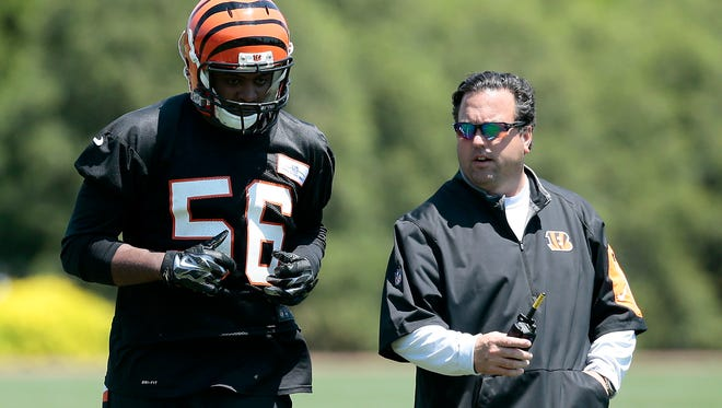 Linebacker Karlos Dansby (56) listens to defensive coordinator Paul Guenther during OTAs at the Bengals' practice field next to Paul Brown Stadium in downtown Cincinnati, on Tuesday, May 24, 2016.