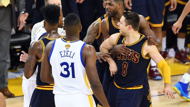 Cleveland Cavaliers guard Matthew Dellavedova (8) is separated from Golden State Warriors forward Andre Iguodala (9) during the third quarter in game one of the NBA Finals.