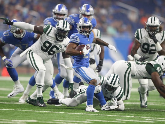 Ameer Abdullah runs against the Jets during first-quarter