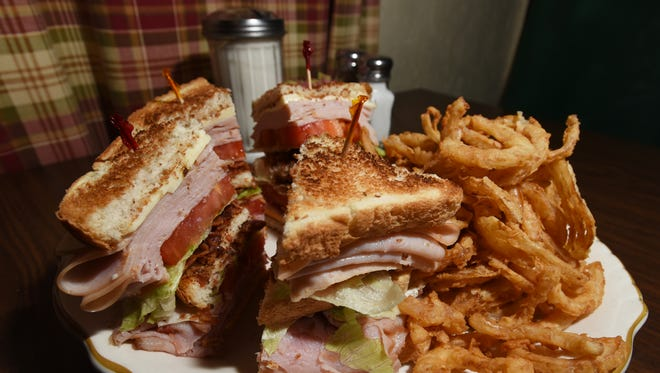 The club sandwich at the Country Corner Family Restaurant near New Concord, with a side of homemade onion rings.