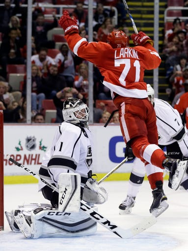 Detroit Red Wings center Dylan Larkin leaps after scoring