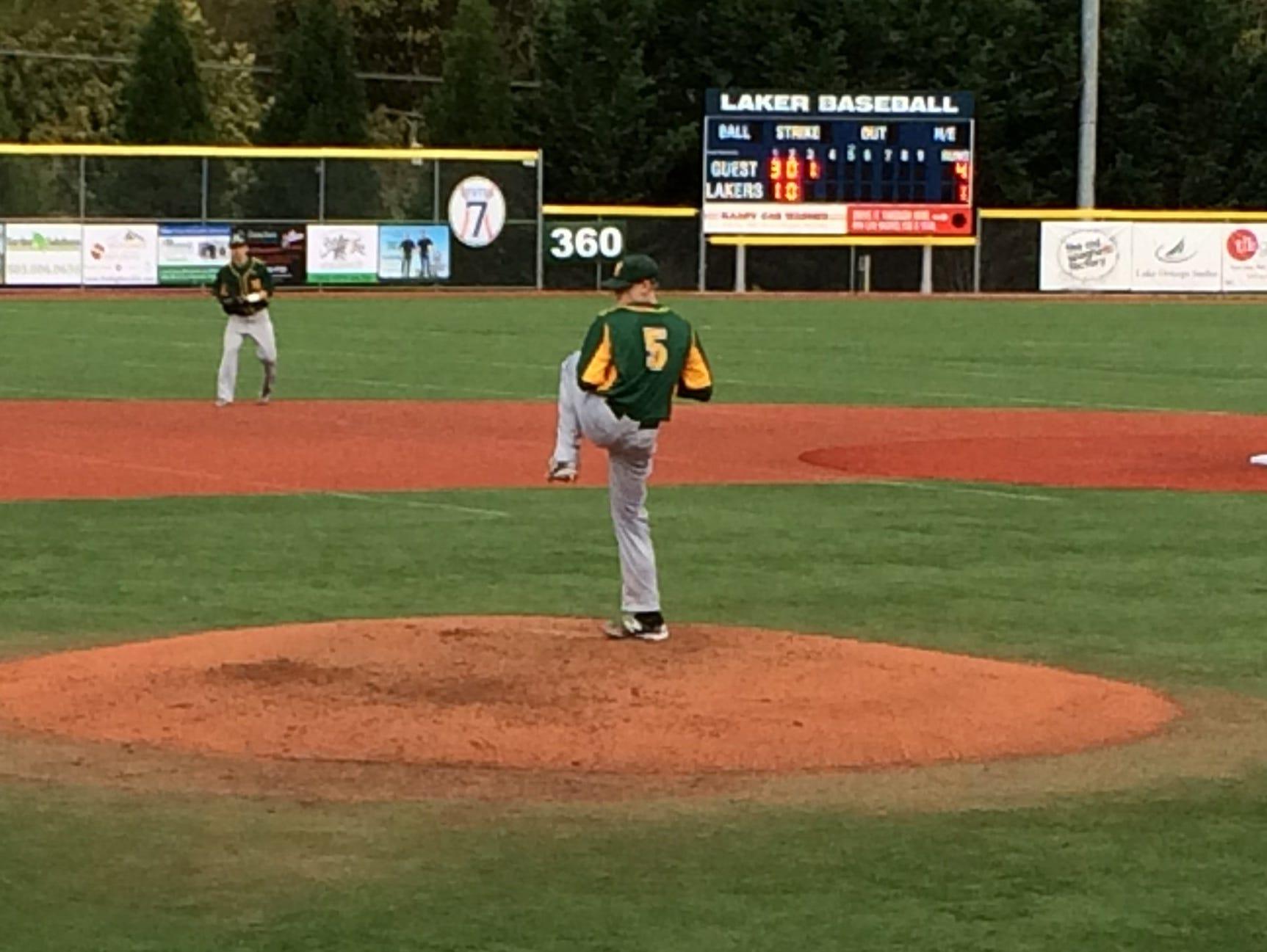 West Linn's Karsen Lindell delivers a pitch against Lake Oswego