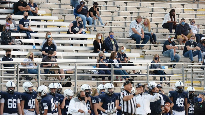 Football fans watch McDowell High School host Cathedral Prep at Gus Anderson Field on Sept. 25, 2020, in Millcreek Township. McDowell has shut down all contests and extra-curricular activities for student-athletes at the moment according to a letter sent out by athletic director Mark Becker.